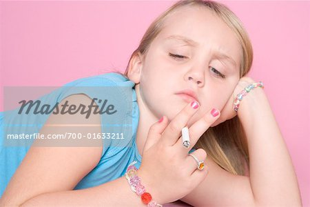 Girl Smoking Cigarette Stock Photo - Rights-Managed, Image code: 700-01633211