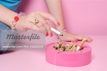 Girl Smoking Cigarette Stock Photo - Rights-Managed, Image code: 700-01633213