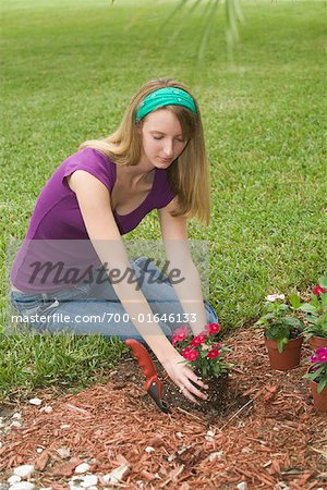 Teenagd Girl Gardening Stock Photo - Rights-Managed, Image code: 700-01646133