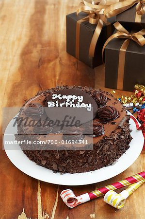 Chocolate Birthday Cake and Gifts    Stock Photo - Premium Rights-Managed, Artist: SEED9, Code: 700-01694341