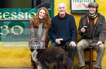 Couple and Man by Pub with Dog, Ireland Stock Photo - Rights-Managed, Image code: 700-01694910