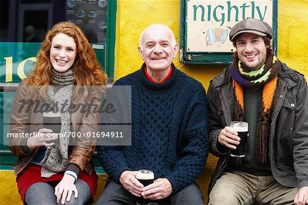 Couple and Man by Pub, Ireland Stock Photo - Rights-Managed, Image code: 700-01694911