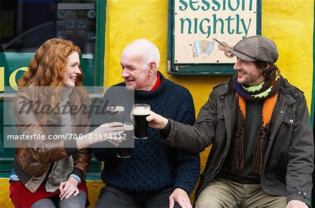 Couple and Man by Pub, Ireland Stock Photo - Rights-Managed, Image code: 700-01694912