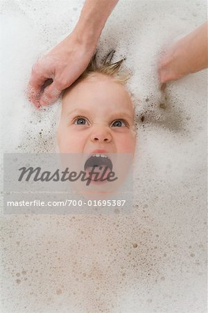 Hands Washing Girl's Hair in Bathtub Stock Photo - Rights-Managed, Image code: 700-01695387