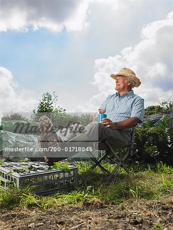 Mature Man Sitting on Chair Outdoors Stock Photo - Rights-Managed, Image code: 700-01718046
