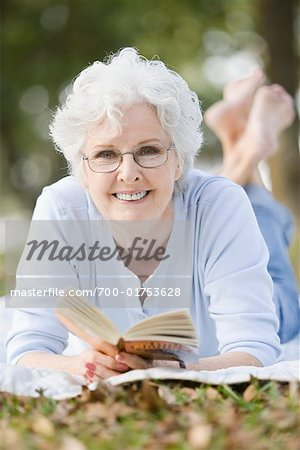 Woman Reading Book Outdoors Stock Photo - Rights-Managed, Image code: 700-01753628