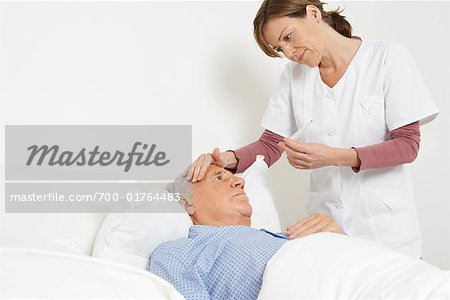 Nurse Taking Patient's Temperature Stock Photo - Rights-Managed, Image code: 700-01764483