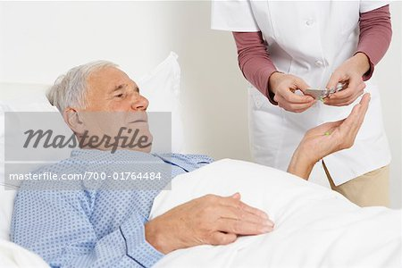 Nurse Giving Medication to Patient Stock Photo - Rights-Managed, Image code: 700-01764484