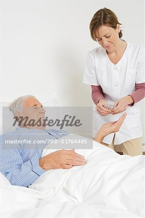 Nurse Giving Medication to Patient Stock Photo - Rights-Managed, Image code: 700-01764485