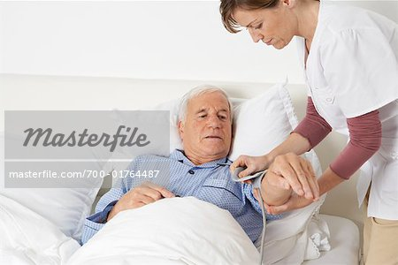 Nurse Checking Patient's Blood Pressure Stock Photo - Rights-Managed, Image code: 700-01764487
