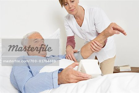 Nurse Checking Patient's Blood Pressure Stock Photo - Rights-Managed, Image code: 700-01764488