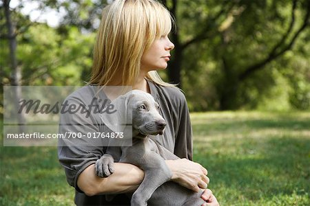 Woman with Dog in Park Stock Photo - Rights-Managed, Image code: 700-01764873