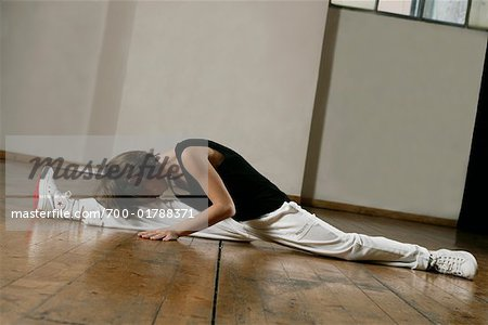 Boy Stretching Stock Photo - Rights-Managed, Image code: 700-01788371