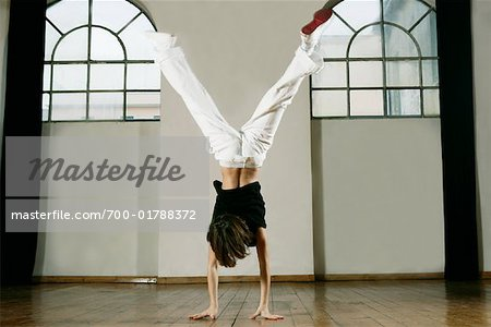 Boy Doing Handstand Stock Photo - Rights-Managed, Image code: 700-01788372
