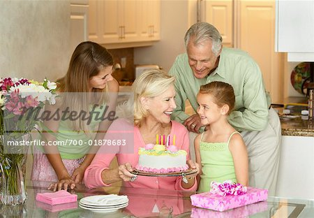 Girl Celebrating Birthday with Sister and Grandparents Stock Photo - Rights-Managed, Image code: 700-01878683