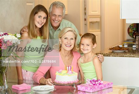 Girl Celebrating Birthday with Sister and Grandparents Stock Photo - Rights-Managed, Image code: 700-01878684