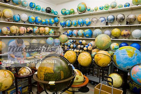 Man Working in Globe Shop, Barcelona, Spain Stock Photo - Rights-Managed, Image code: 700-01879661