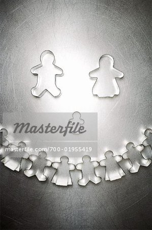Gingerbread Man and Woman Cookie Cutter Family with Semicircle of Others Stock Photo - Rights-Managed, Image code: 700-01955419