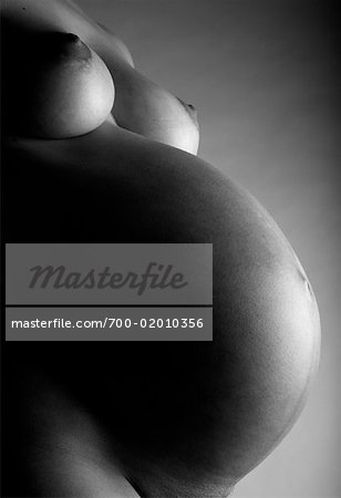 Close-up of Pregnant Woman's Belly Stock Photo - Rights-Managed, Image code: 700-02010356