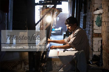 Man Working on Loom, Varanasi, India Stock Photo - Rights-Managed, Image code: 700-02047033