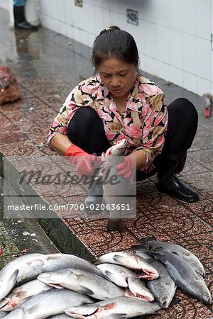 Woman Cleaning Fish, Ben Thanh Market, Ho Chi Minh City, Vietnam