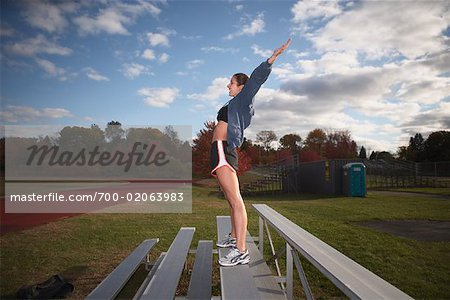 Woman Exercising on Bleachers Stock Photo - Rights-Managed, Image code: 700-02063983