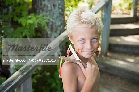 Portrait of Boy Holding Slingshot Stock Photo - Rights-Managed, Image code: 700-02071313