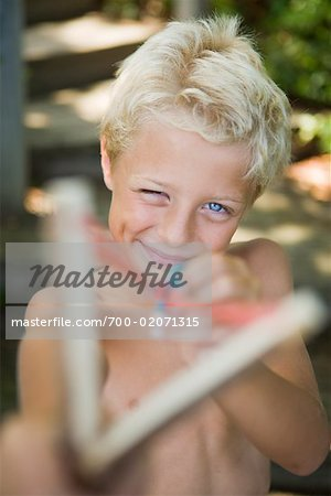 Boy Aiming Slingshot Stock Photo - Rights-Managed, Image code: 700-02071315