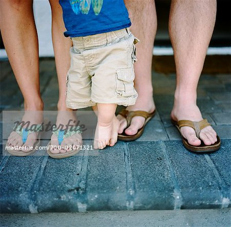 Close-Up of Family's Legs Stock Photo - Rights-Managed, Image code: 700-02071321