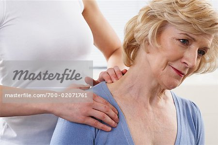 Close-up of Woman Getting Neck Massaged Stock Photo - Rights-Managed, Image code: 700-02071761
