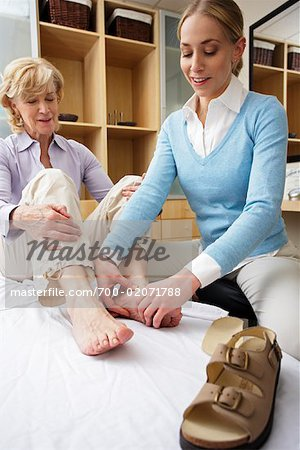 Physiotherapist Examining Woman's Foot Stock Photo - Rights-Managed, Image code: 700-02071788
