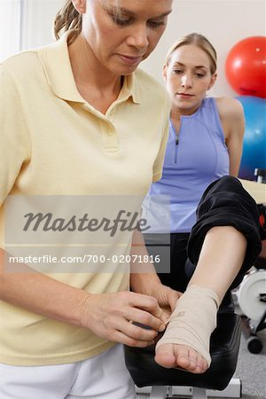 Physiotherapist Examining Woman's Foot Stock Photo - Rights-Managed, Image code: 700-02071816