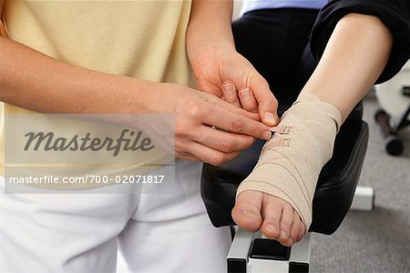 Close-up of Physiotherapist Examining Foot Stock Photo - Rights-Managed, Image code: 700-02071817