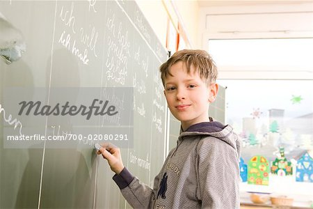 Student Writing on Blackboard Stock Photo - Rights-Managed, Image code: 700-02080291