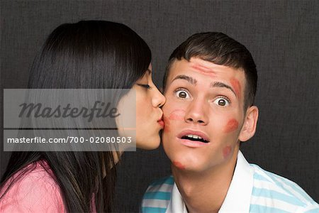 Woman Kissing Man Stock Photo - Rights-Managed, Image code: 700-02080503