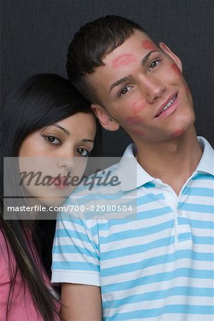 Portrait of Couple, Boy Covered in Kisses Stock Photo - Rights-Managed, Image code: 700-02080504