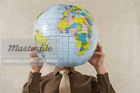 Businessman Holding Globe Stock Photo - Rights-Managed, Image code: 700-02080518