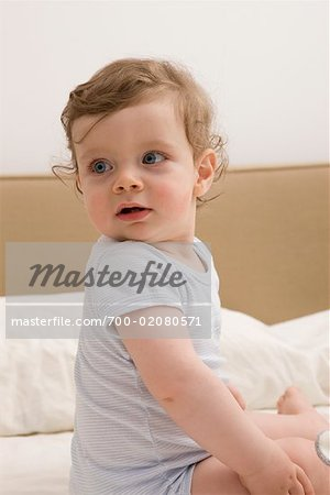 Portrait of Boy on Bed Stock Photo - Rights-Managed, Image code: 700-02080571