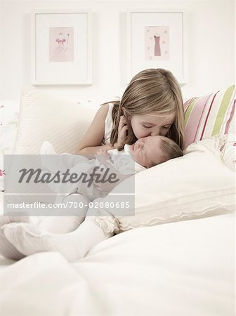 Girl Kissing Baby Brother on Bed Stock Photo - Rights-Managed, Image code: 700-02080685