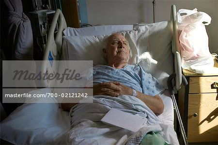 Man Lying in Hospital Bed Stock Photo - Rights-Managed, Image code: 700-02121242