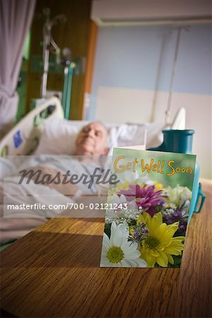 Elderly Man in Hospital with Get Well Soon Card on Table Stock Photo - Rights-Managed, Image code: 700-02121243