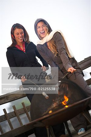 Women Toasting Marshmallows over Fire Stock Photo - Rights-Managed, Image code: 700-02125538