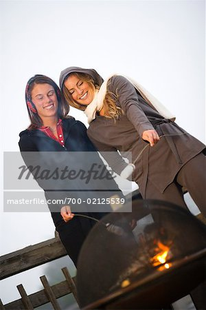 Two Women Roasting Marshmallows Over Fire Stock Photo - Rights-Managed, Image code: 700-02125539