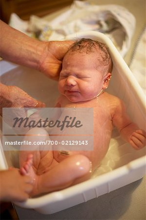 Newborn Baby Having First Bath Stock Photo - Rights-Managed, Image code: 700-02129143