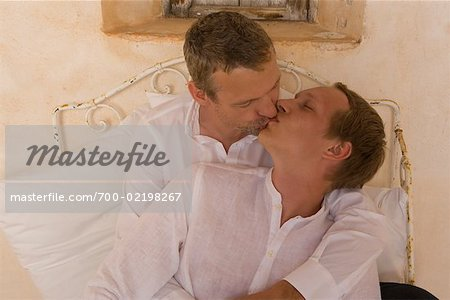Couple Kissing in Bed Stock Photo - Rights-Managed, Image code: 700-02198267