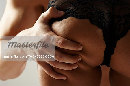 Man Squeezing Woman's Buttock Stock Photo - Rights-Managed, Image code: 700-02200000