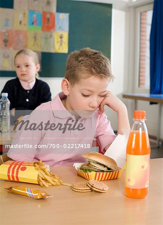 Student Falling Asleep at Desk at Lunchtime Stock Photo - Rights-Managed, Image code: 700-02217418