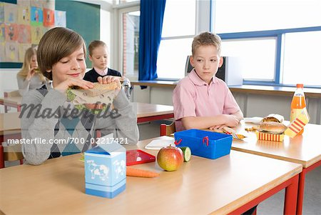 Boy with Fast Food Lunch Looking at Boy with Healthy Lunch Stock Photo - Rights-Managed, Image code: 700-02217421