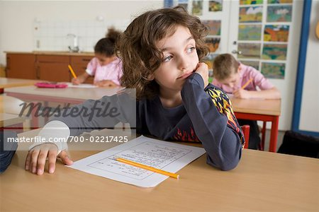 Boy Daydreaming while other Students Take Test Stock Photo - Rights-Managed, Image code: 700-02217425