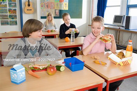 Children Eating Lunch in Classroom Stock Photo - Rights-Managed, Image code: 700-02217427